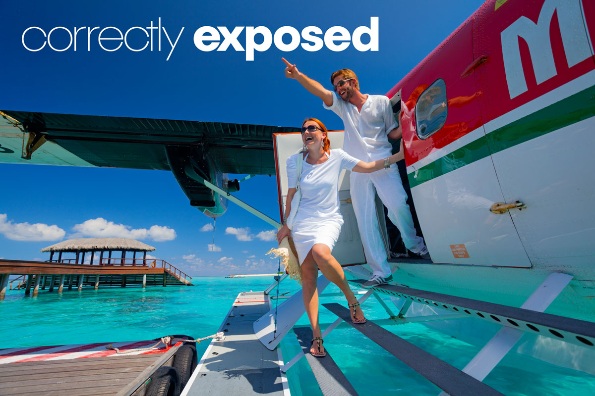 correctly exposed image of couple exiting seaplane on Maldives