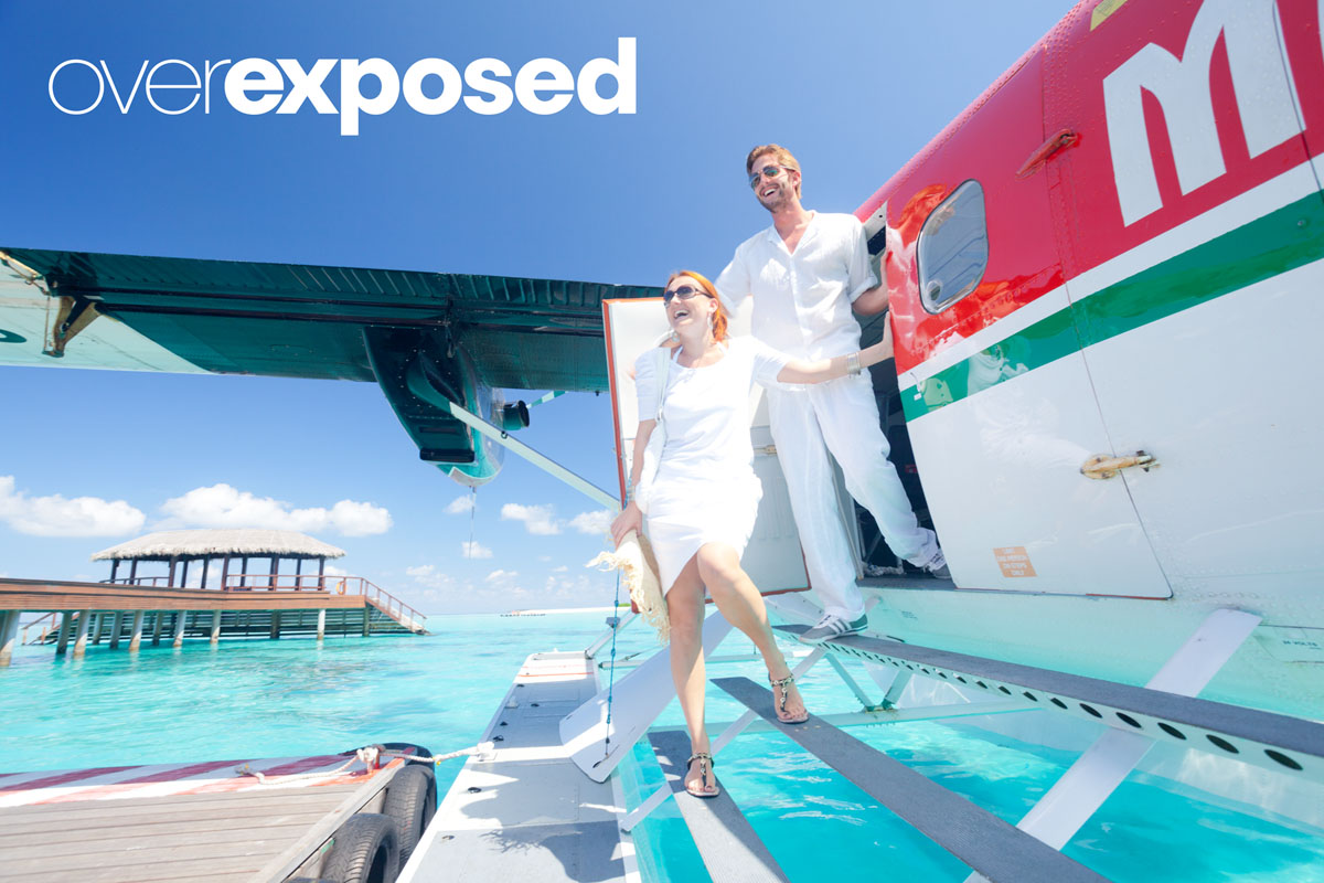 overexposed image of couple exiting seaplane